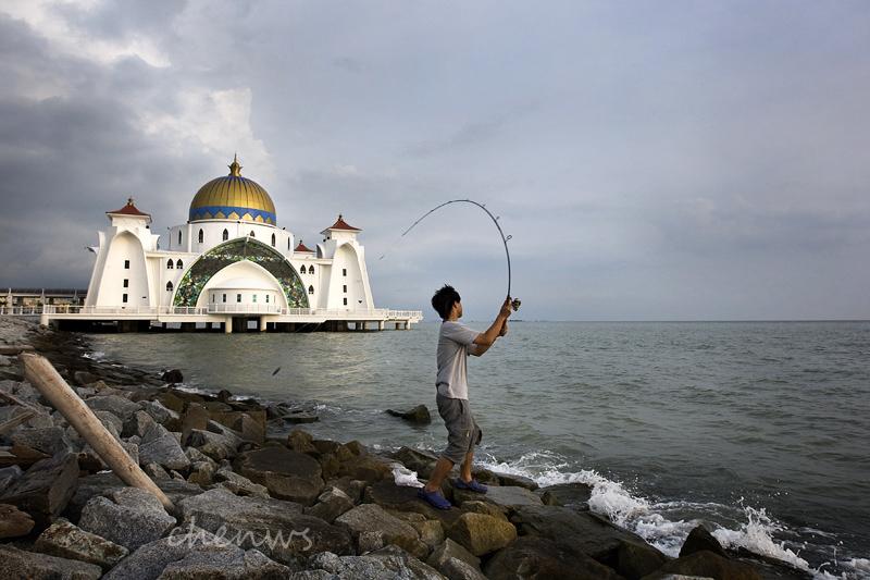 Angler at Malacca Straits Mosque