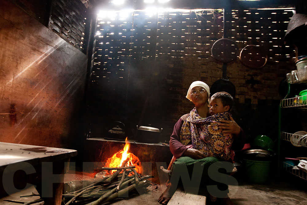 Grandmother and boy in the kitchen
