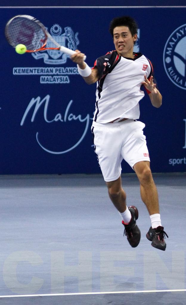 Kei Nishikori (Japan) in action at the ATP Malaysia Open 2011