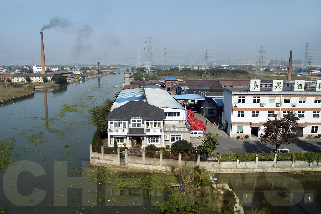 View of suburbs of Shanghai as seen from a bullet train ride from Hangzhou.