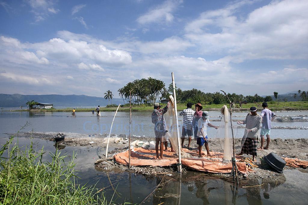 Villagers fishing at Lake Singkarak