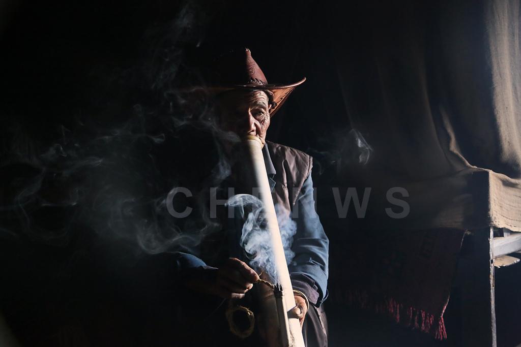 Man smoking, QingKou village
