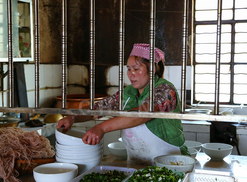 Cook at YouYiChun noodle restaurant