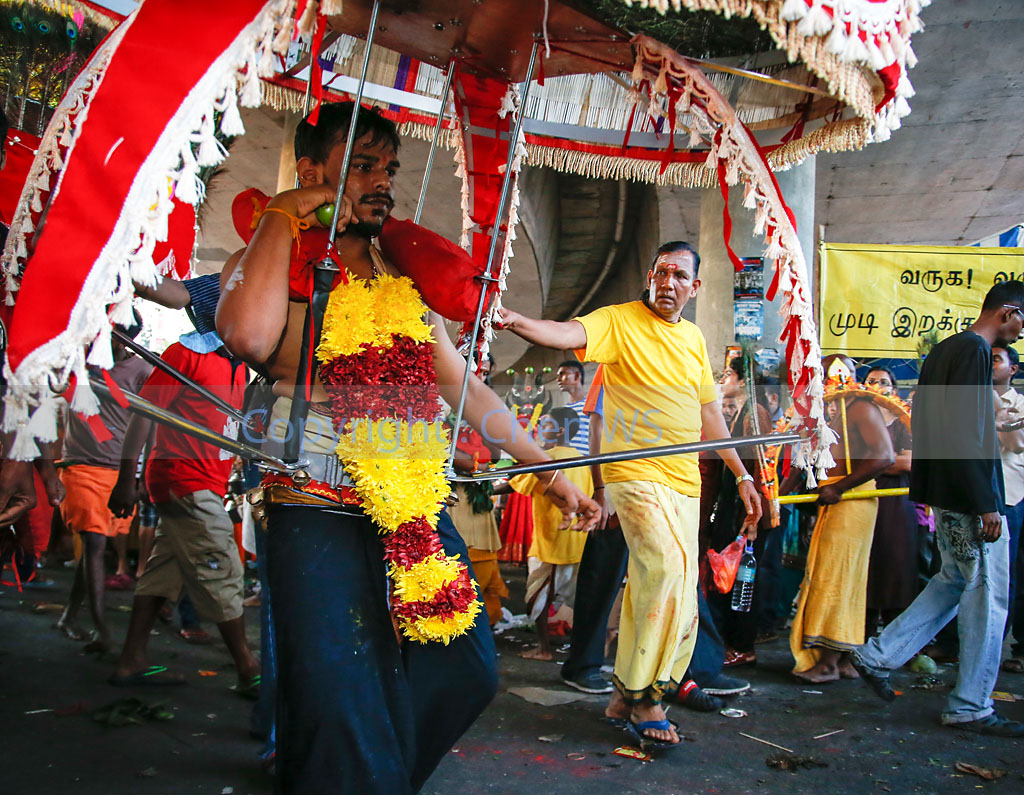 Carry the kavadi to the temple up the steps