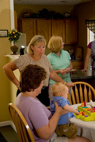 Aunt Janice holding Jack with Aunt Lynn looking on