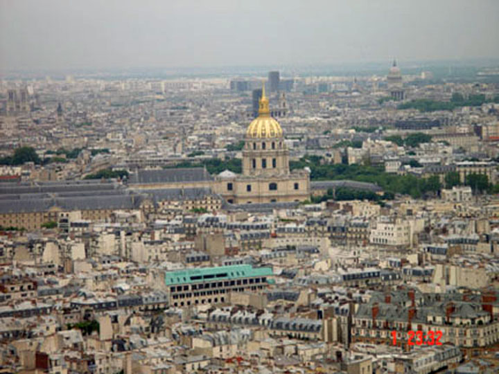 The grandeur of Paris embellished by the Golden Dome of Les Invalides and the Place de La Concorde, seen from the Eiffel Tower.