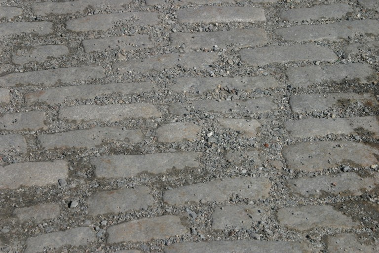 cobblestone street beneath pavement that ran between the Strand and the Modern