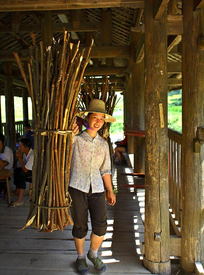 3535 Hauling firewood of Cunninghamia limbs through the wind rain bridge near new drum tower.