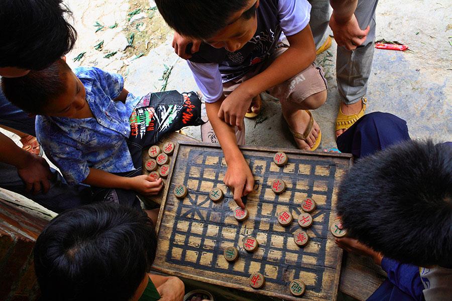4336 Boys playing checkers.