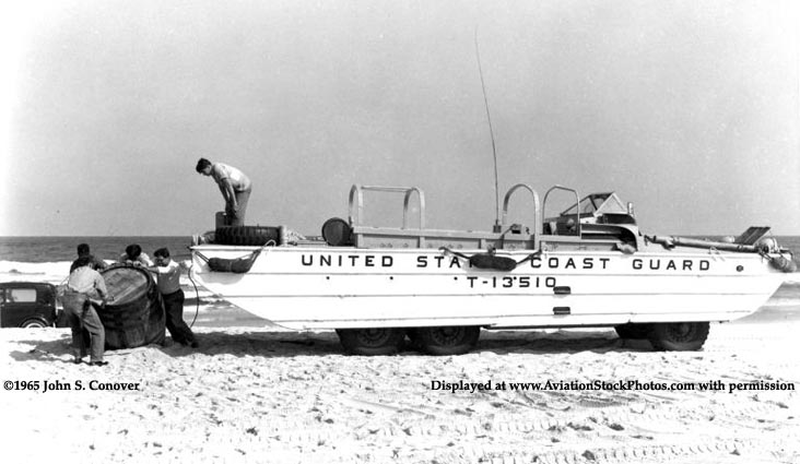 1965 - Coasties and a Coast Guard Duck (DUKW) amphibious vehicle