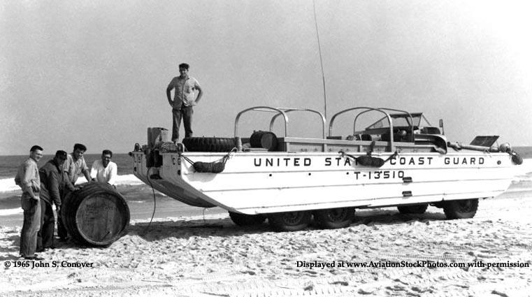 1965 - Coasties and a Coast Guard Duck (DUKW) amphibious vehicle