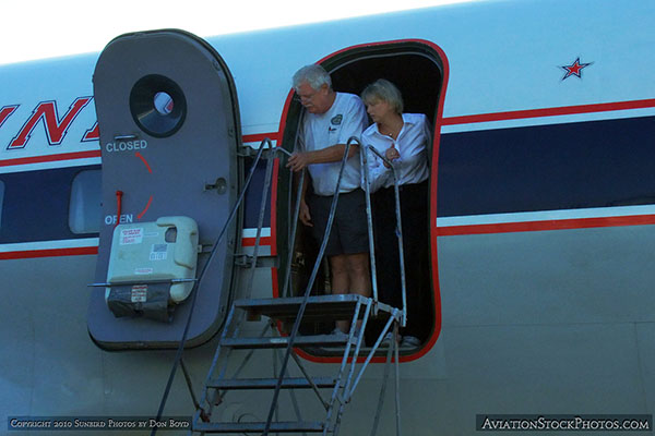 2010 - Roger Jarman and stewardess onboard the HFFs restored Eastern Air Lines DC-7B N836D aviation stock photo #1264