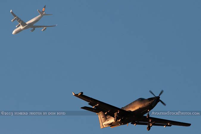 U. S. Special Operations Command (USSOCOM) Pilatus U-28A #08-0646 (formerly N875RJ) and Lufthansa A340-313X D-AIGS stock photo