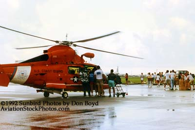 1992 - Coast Guard operations after Hurricane Andrew - HH-65 and volunteers loading supplies