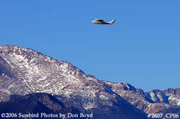 Gregory D. Eastons Cessna T210H N2234R with Pikes Peak in the background private aviation stock photo #2607