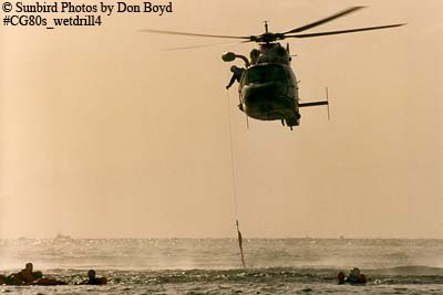 Late 80s - USCG HH-65 #6525 hoisting Coast Guard Reserve air crew members during wet drill