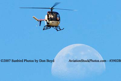 L J Air Corporations Schweizer 269C N17YS helicopter and the moon aviation stock photo #3902B
