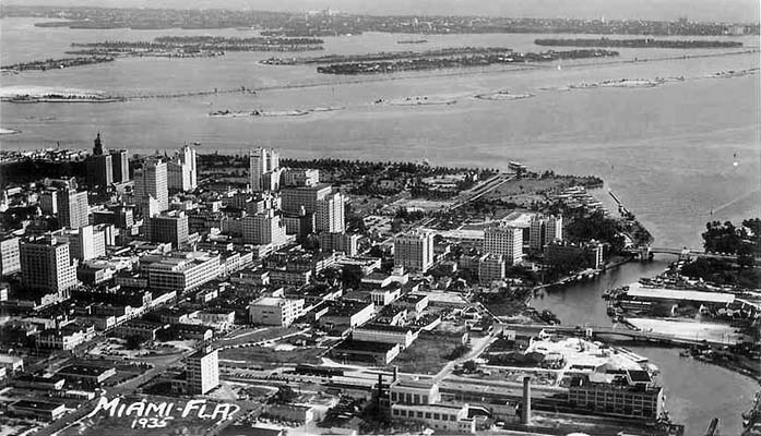 1935 - aerial of downtown Miami, entrance to the Miami River and Biscayne Bay