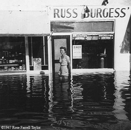 1947 - Rose Farrell Taylor in front of Ross Burgess Ice Cream Store after the Flood of 1947