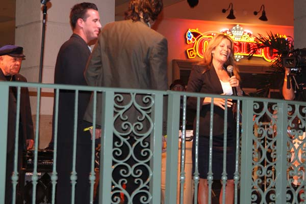 TV newscaster Michelle Gillen speaking about Rick (left) at his retirement party