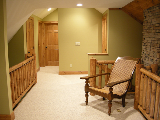 Game area on second floor leads into two more bedrooms.