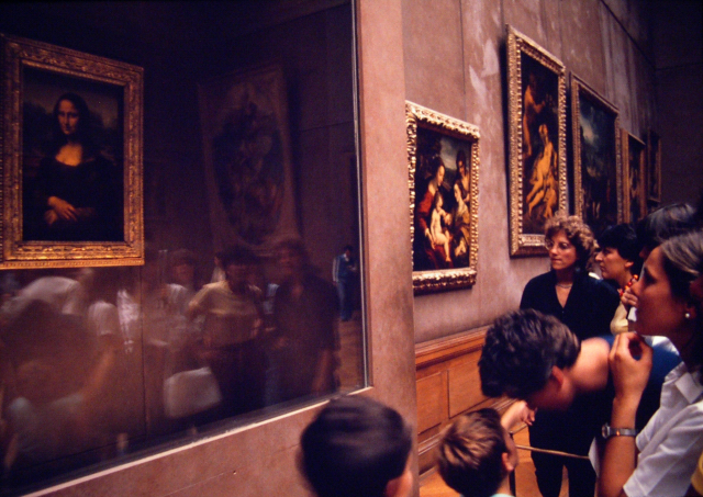 Viewing the Mona Lisa at the Louvre, Paris, 1982.