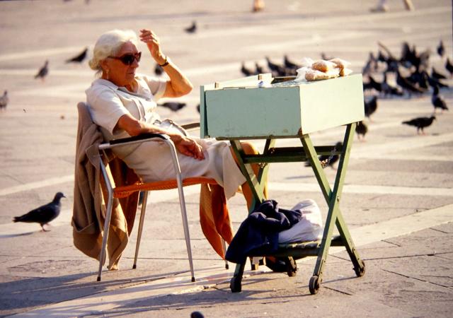 Bird-seed vendor, Piazza San Marco, Venice, 1982.