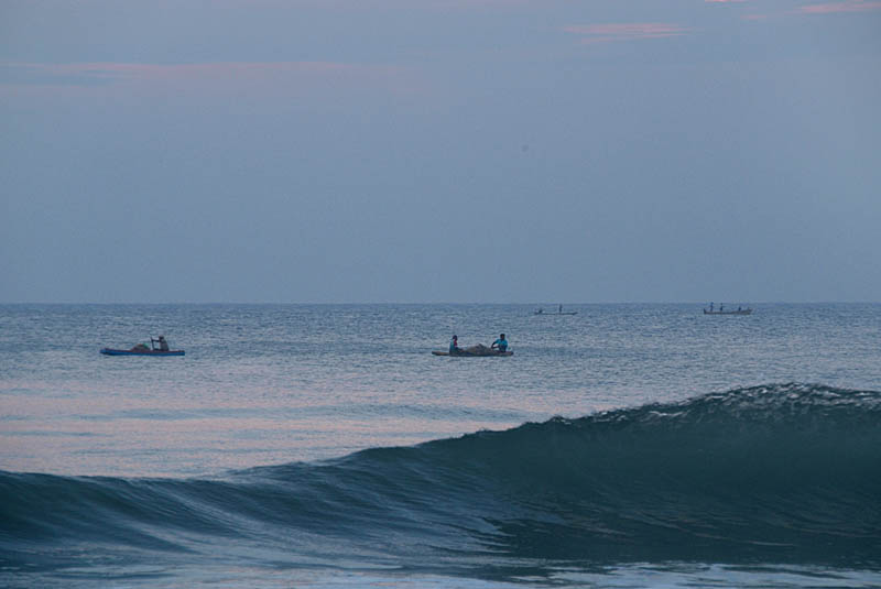 Fishing Boats and Waves near Dawn