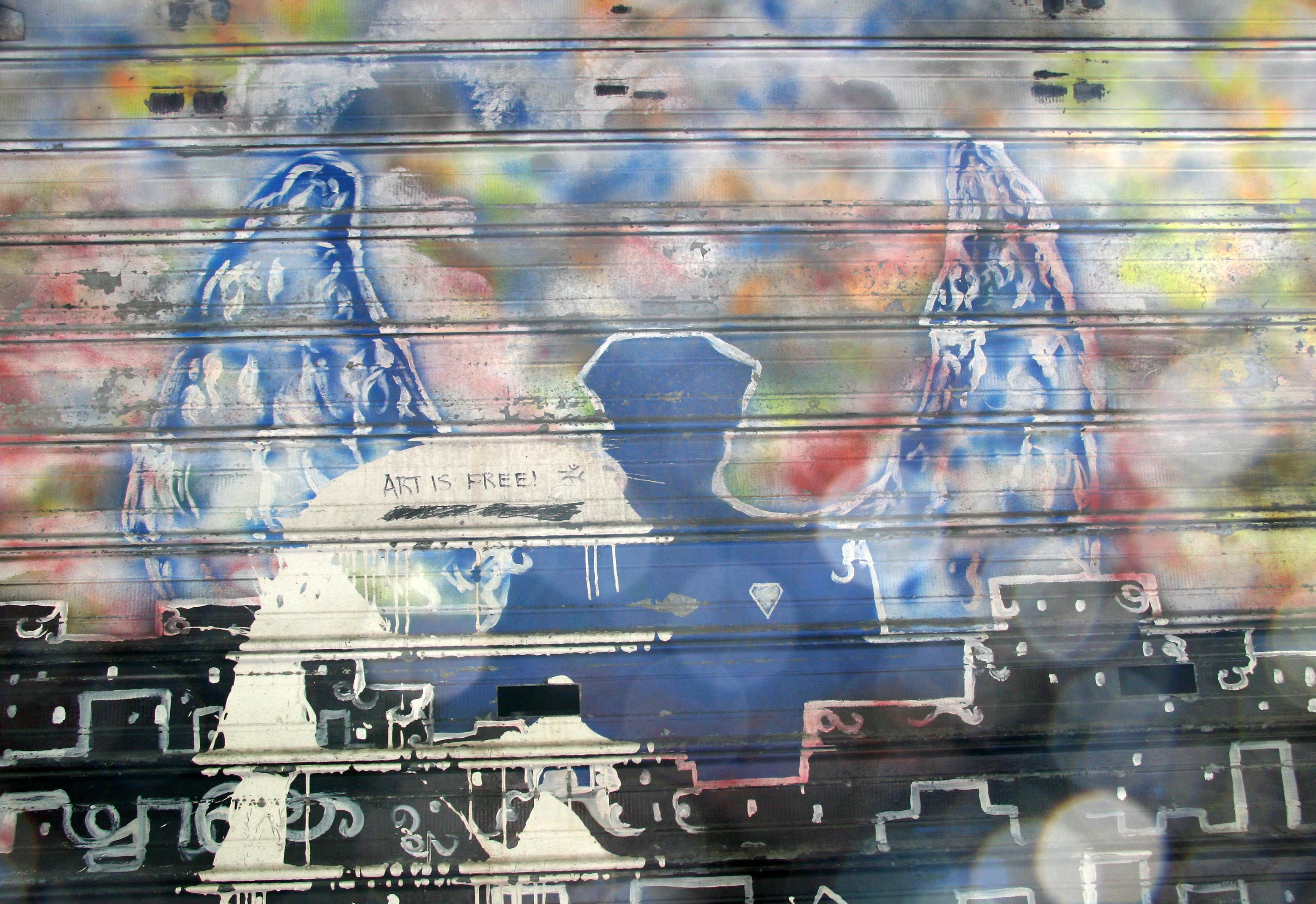 911 Mural on a Shop Window Metal Blind