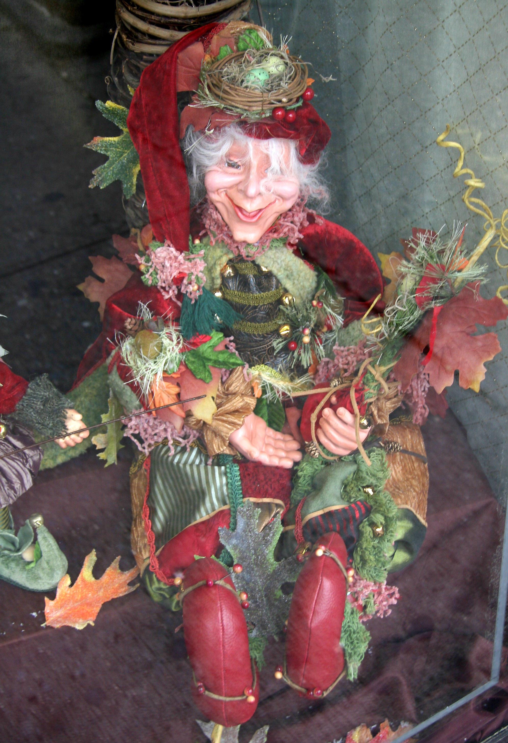 Elf in Avignon Pharmacy Window at Father Demo Square