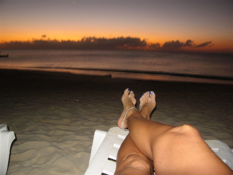 sitting on the beach enjoying the sunset