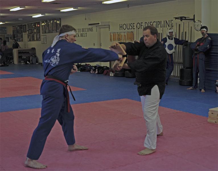 Rick Breaking Board with punch.jpg