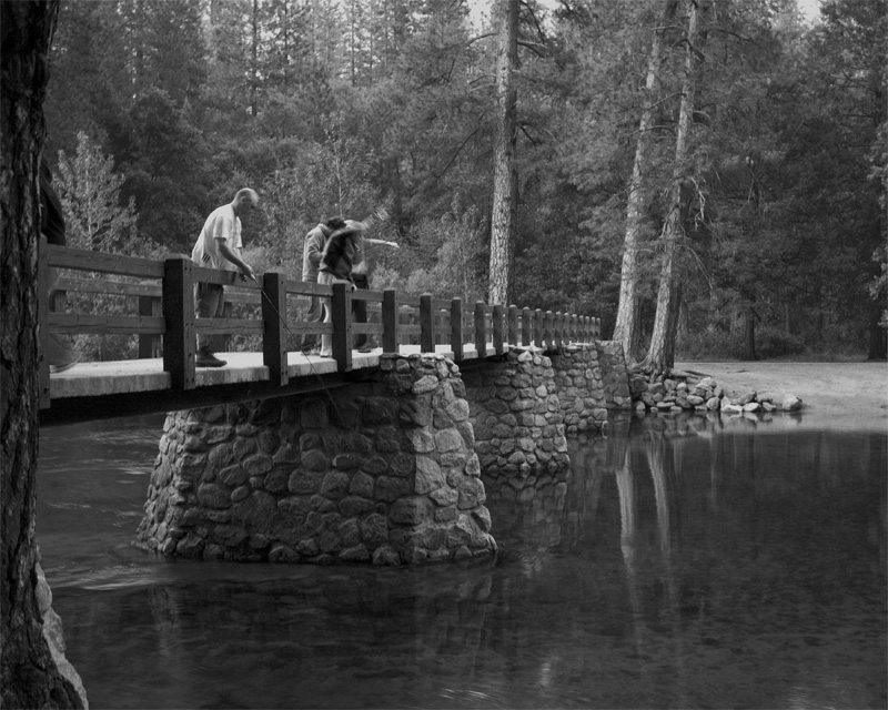 Fishing from the Merced River Foot Bridge Black and White.jpg