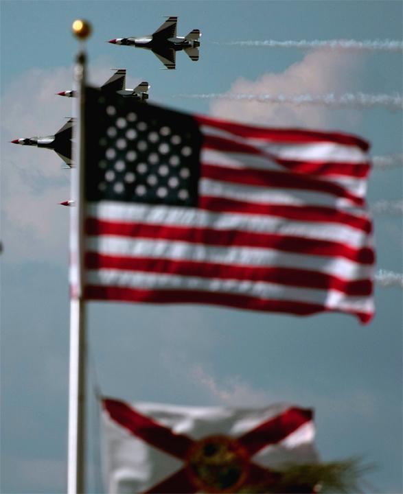 Quartet flying behind flags.jpg