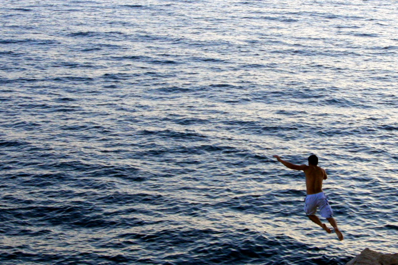 Leap of faith, cliff diving, walls of Dubrovnik