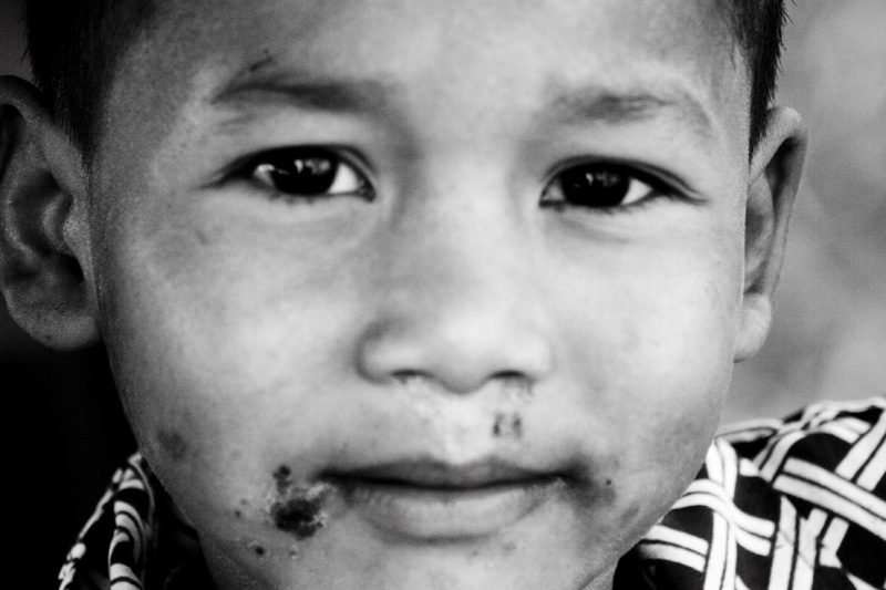 One of the kids living in the village by the garbage