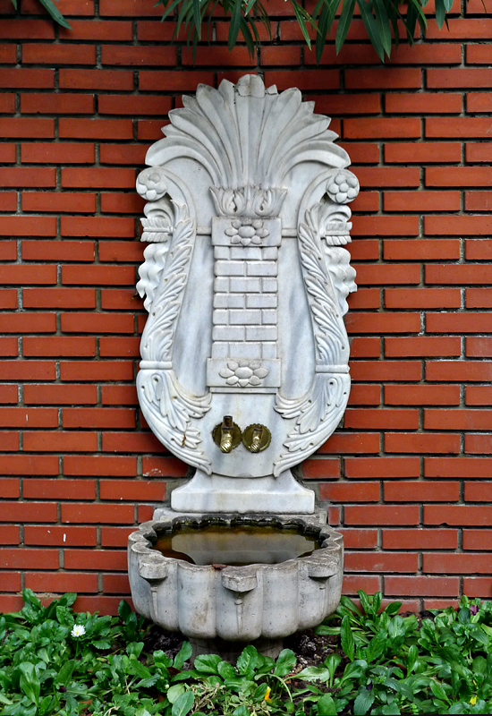 Old fountain, modern backdrop