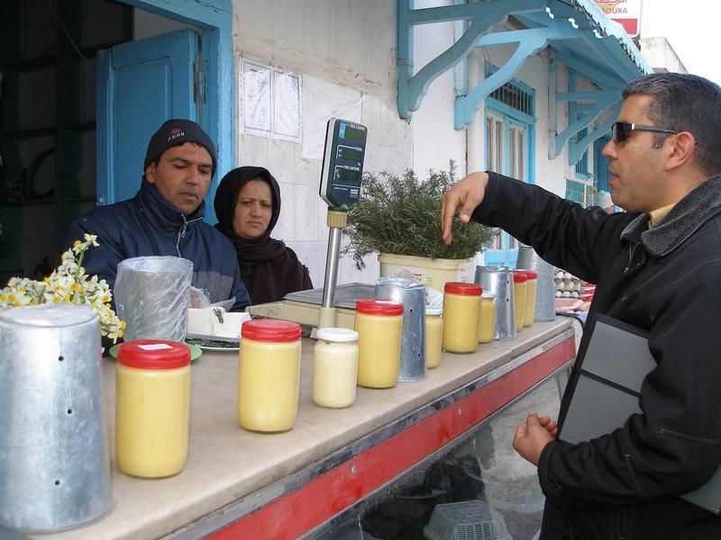 Ali buys us Tunisian sheep cheese in Testour