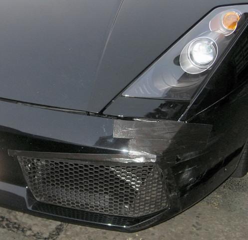 Front left of priceless Lamborgini with 10 cent tape repair on bumper.