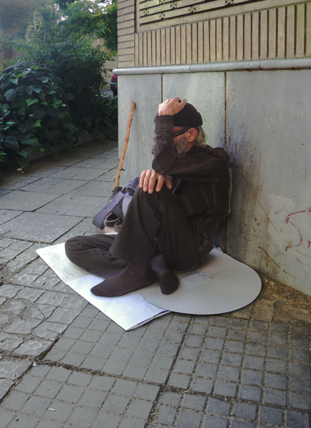 Another View of a Sitting Beggar