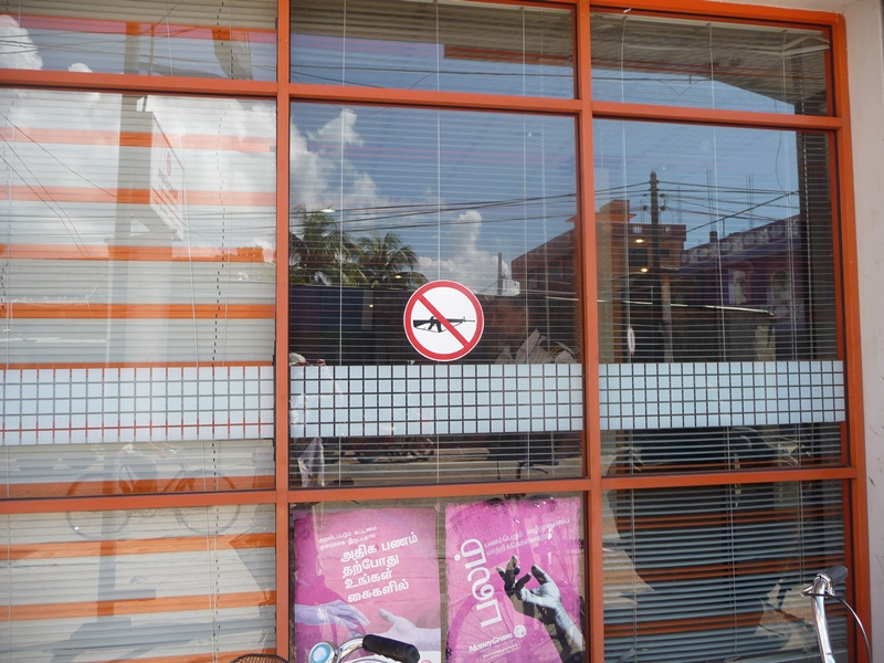 No guns allowed - sign in bank window