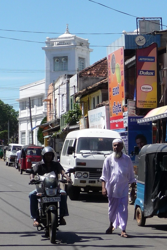 Street scene with mosque in background