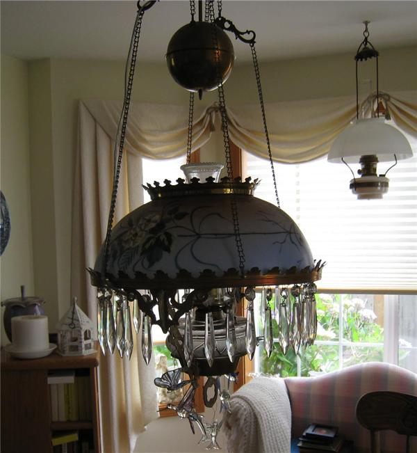 Dining Room Chandelier With Unconverted Oil Lamp In Bay Window
