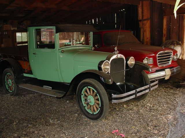 Ford pickup truck<br>Studebaker in background