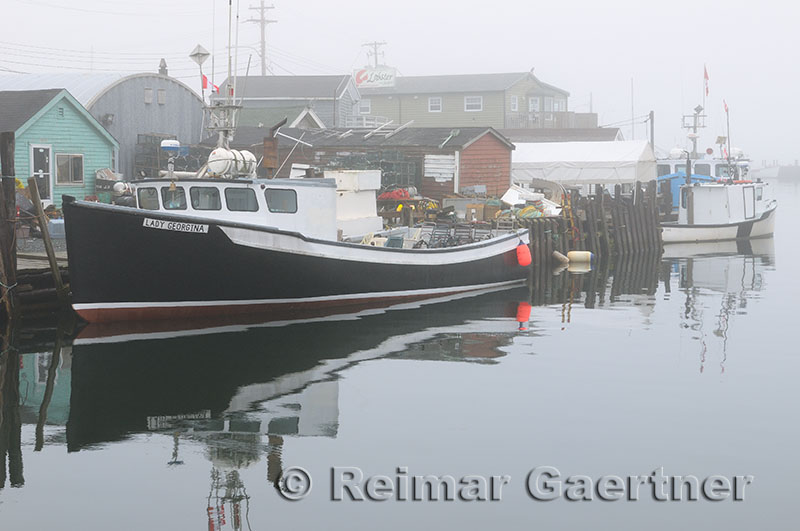 Tour boat in fog at Fishermans Cove Eastern Passage Halifax Nova Scotia