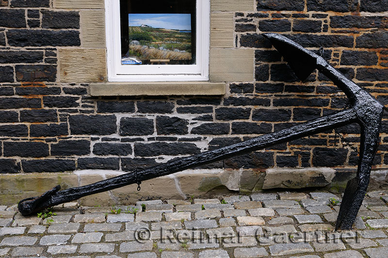 Painting in window and old black anchor in Old Halifax Nova Scotia