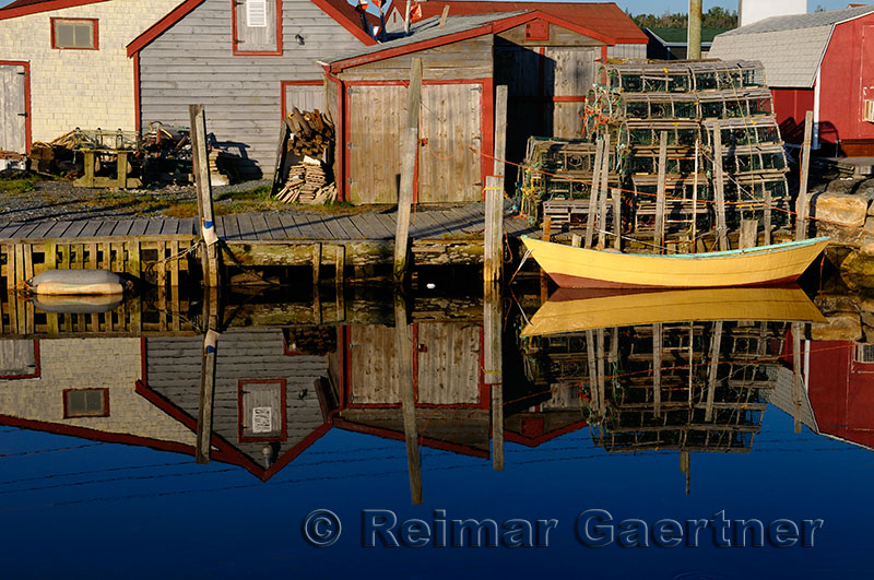 Quiet yellow and brown boat at Fishermans Cove Eastern Passage Halifax Nova Scotia
