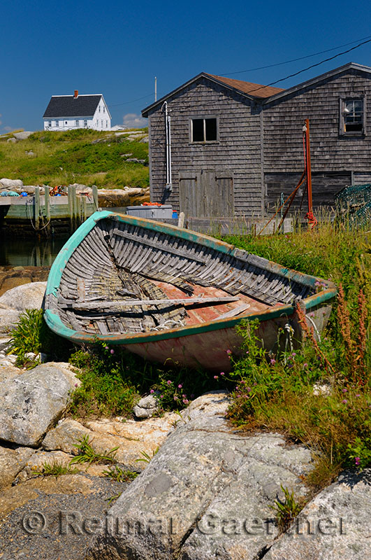 Abandoned boat on the rocks in full sun at Peggys Cove Nova Scotia