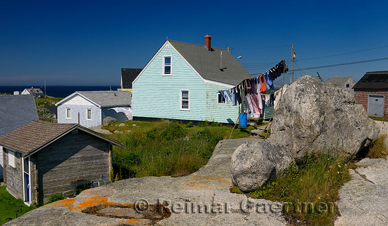 Rural fishing village houses and laundry at Peggys Cove Nova Scotia