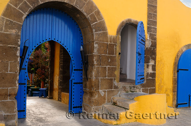 Colorful blue doors on a yellow building in Casablanca Morocco